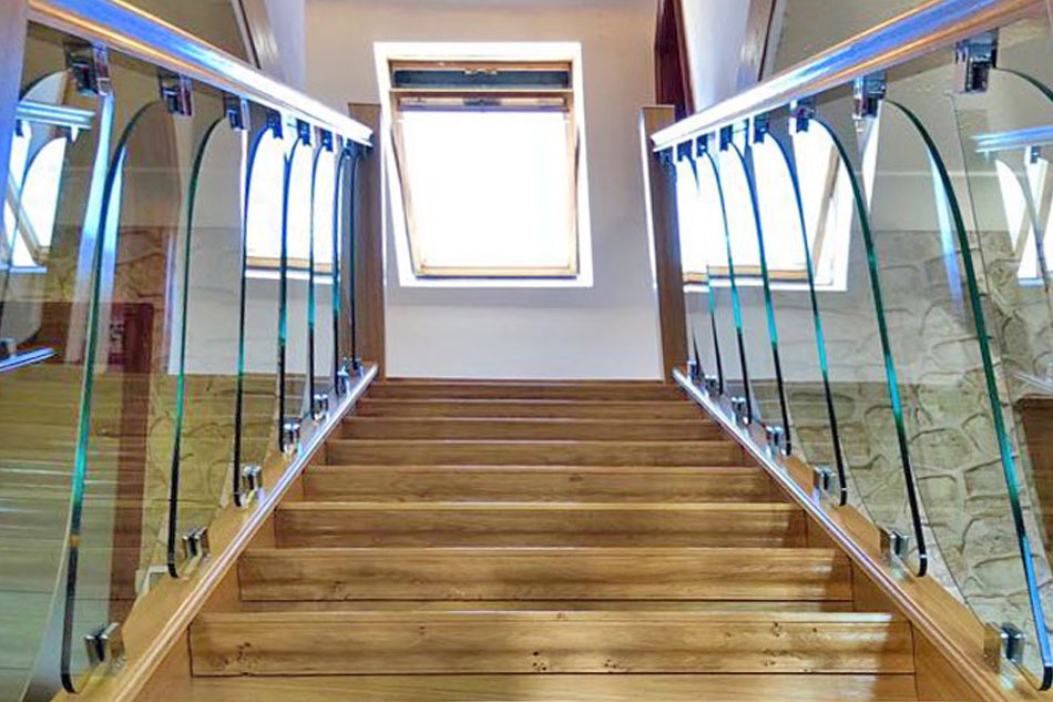Heritage-stair-cladding-and-glass-stairprts-transform-a-tired-out-of-date-staircase-featured-image