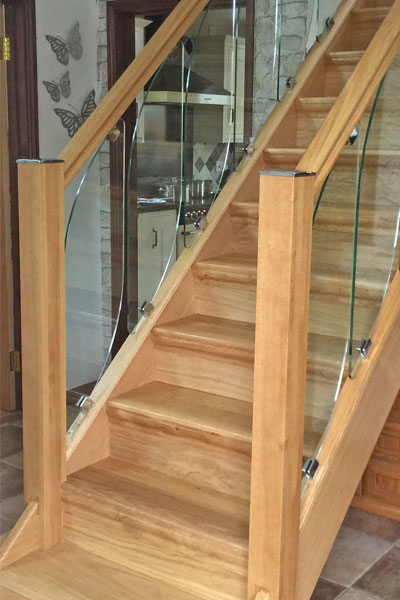 Heritage-stair-cladding-and-glass-stairprts-transform-a-tired-out-of-date-staircase